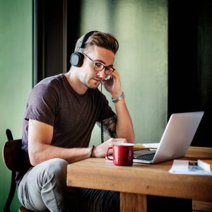 man working and developing playlists on mac